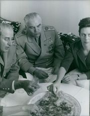 Rodion Yakovlevich Malinovsky eating together with other member. 1962