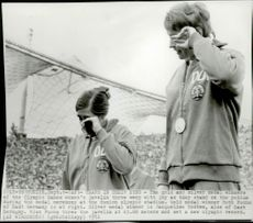 Gold and silver medalists in spears, Ruth Fuchs and Jacqueline Todten, both from East Germany, could not hold back their tears.