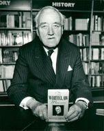 Viscount William Whitelaw holds his book 'The Whitelaw memoirs'