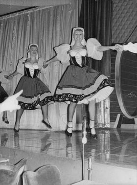 Women performing on stage.