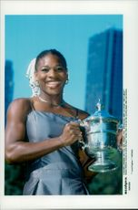 Happy Serena Williams with the trophy in hand after winning the US Open.