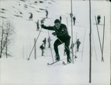 A man enjoying skiing on snow.