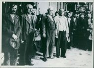 Farmers from Dubica standing together while looking towards the camera during an event.