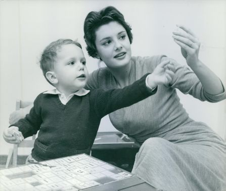 Italian actress Rossana Podestà teaches the alphabet to her three years old son Stefano using plastics.