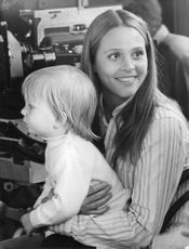 Leigh Taylor-Young with a baby.