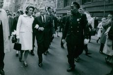 Nelson and Happy Rockefeller walking the streets.