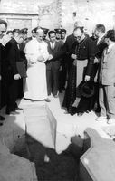 Pope Paul VI standing with men.