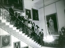 Miss World candidates standing on the stairs, 1963.