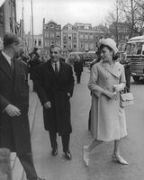 Prince Philip, Mohammad Reza Pahlavi and wife Farah walking together.  - 1962