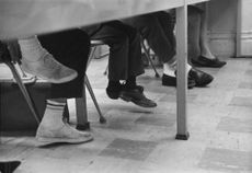 Charles, Prince of Wales feet dangle far from the floor in a French class at Tampa U. Campus Moreland.