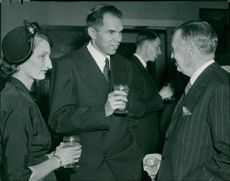 Nobel Prize winner Seaborg with his wife converses with Manne Siegbahn