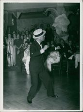 Maurice Chevalier dancing in ceremony.