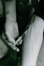 A man injecting a drug in his body, 1973.