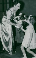 Louise Mountbatten receives flowers of a small rose in French school