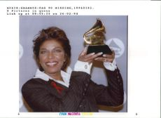 Natalie Cole:Holds up her grammy