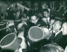 Mehdi Ben Barka surrounded by people.