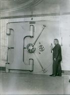 A man opening the security vault, 1929.