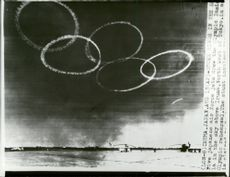 Five jet planes from the Japanese Air Force create the Olympic rings with smoke in the sky