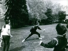 Robert Sargent Shriver playing balls with the kids. 1968.