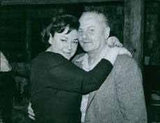 Darryl Zanuck pictured hugging unknown woman. 1963.