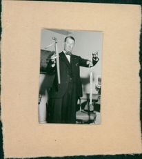 Maurice Auguste Chevalier showing.