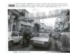 Banners showing President Hafez al-Assad.