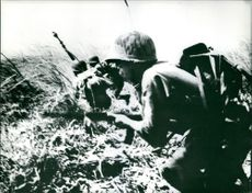 Troops in action in Indochina, 1961.