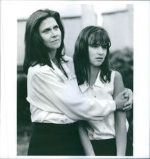 "A photo of Cindy Pickett as Jill and Juliette Lewis as Cassie in the film ""Crooked Hearts"". 1991."