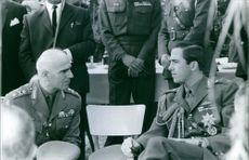 Portrait of a Greek military Stylianos Pattakos siting and talking to another military man. 1967