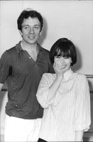 Leslie  Caron with a man, smiling.