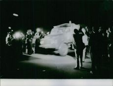 People gathered around military vehicle.  1972