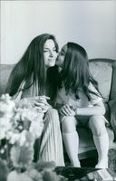 Jacqueline Boyer, a young lady kissing her cheek, 1971.