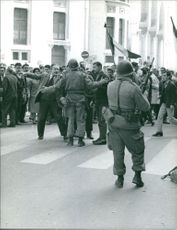 Civilian men asking something to a soldier.  Taken - 30 Mar. 1962
