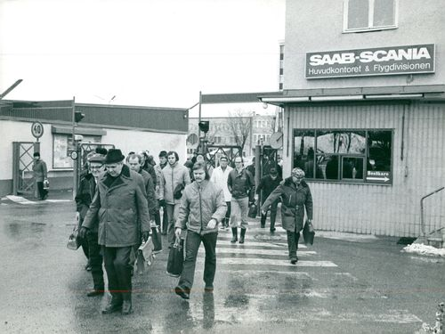 Some of the flight division's approximately 5500 employees leave the Saab-Scania factory after one day's work