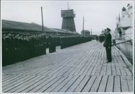 A group of Marine standing and listening to their officer during Norway War.