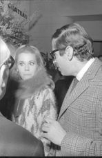 Roger Vadim standing with a woman.