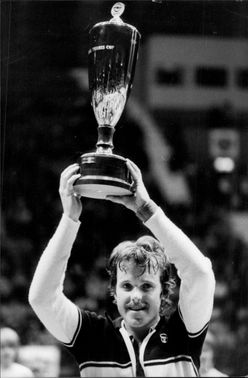 The tennis player Wojtek Fibak holds up a trophy