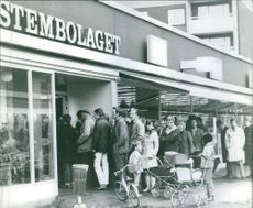 People lined up outside a shop. Systembolaget is a government owned chain of liquor stores in Sweden. It is the only retail store allowed to sell alcoholic beverages that contain more than 3.5% alcohol by volume.