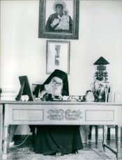 Athenagoras I writing at his desk in his office. 1967.