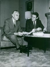 William Averell Harriman sitting with reporter beside him and having conversation.