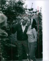 Lorne Greene smelling the flower with his wife Nancy Deale.