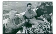 Joe Mantegna, Max Pomeranc and Laurence Fishburne in a scene from a 1993 American drama film,