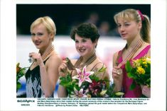 Irina Slutskaya, Viktoria Volchkova and Maria Butyrskaya, show their medals during the award ceremony of the women's free program for the European Figure Skating Championships in Vienna.