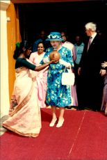 Queen Elizabeth II receives a gift from a fool while visiting Kochi