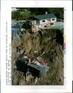 The 1994 Northridge earthquake USA:half of an expensive home lays in ruin.