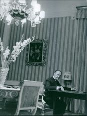 British novelist William Somerset have sitting in the living room and have looked towards the camera