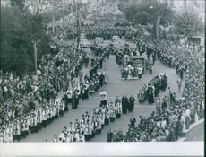 A photo of bishop and priest during parade.