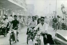 Young people riding the bicycle during the parade.