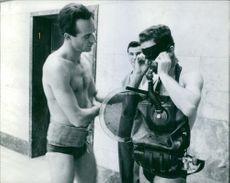 Man getting ready for swimming.