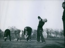 Footballers exercising and practicing during training. 1943